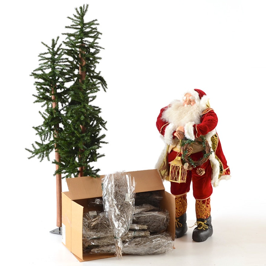 santa statue small tree stand and bouquets of tinseled foliage
