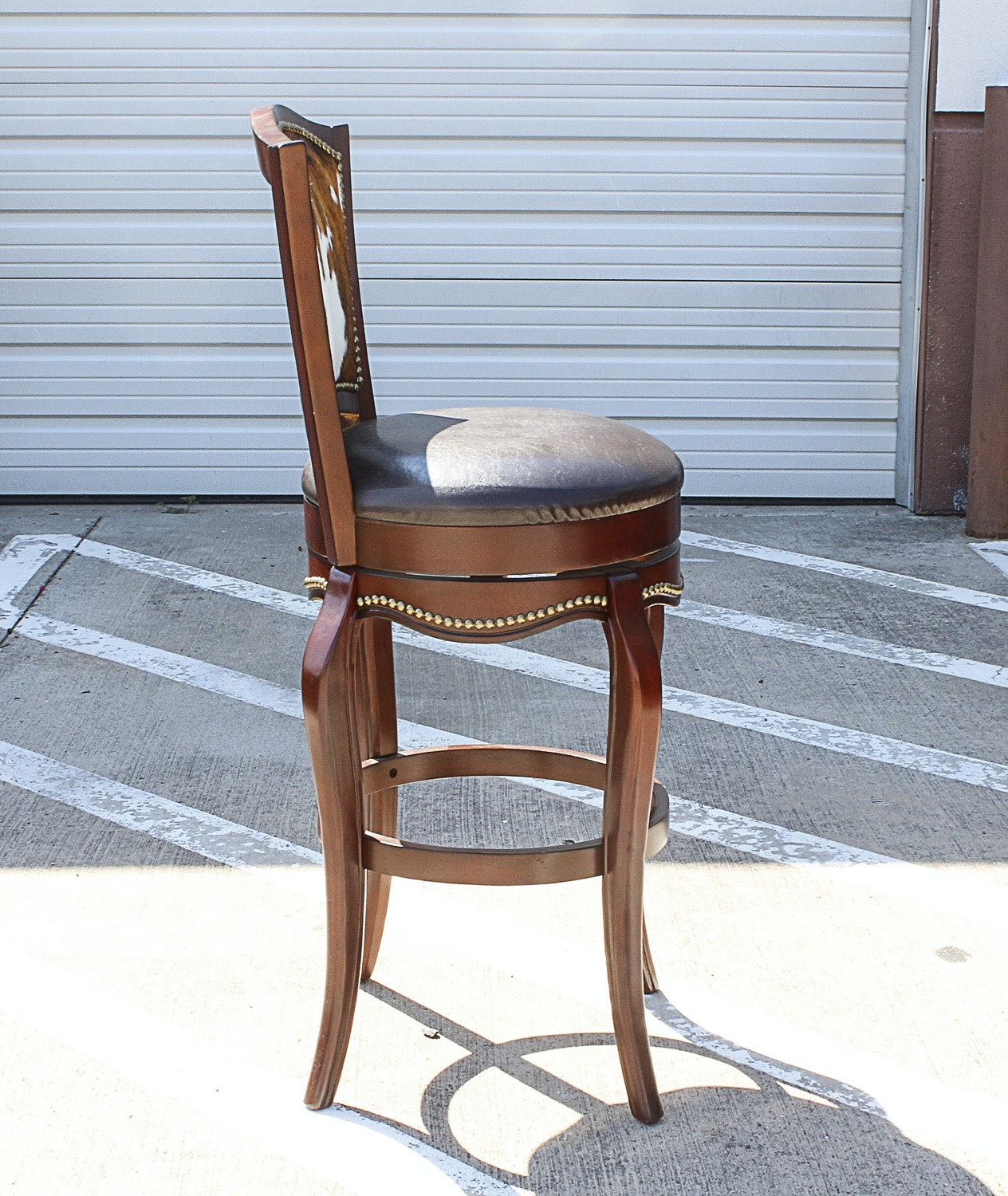 Three Leather And Cowhide Upholstered Barstools Ebth