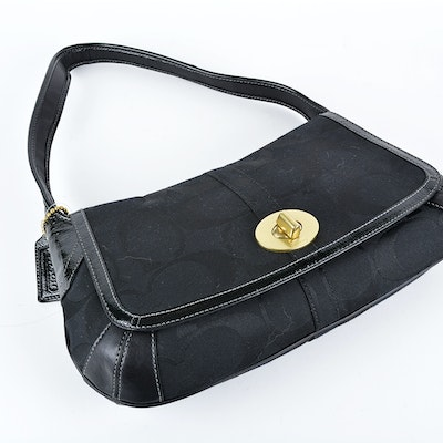 8b76442ab21 ... Black leather Coach handbag with front and Little Coach Ergo Flap Hobo  Bag ...