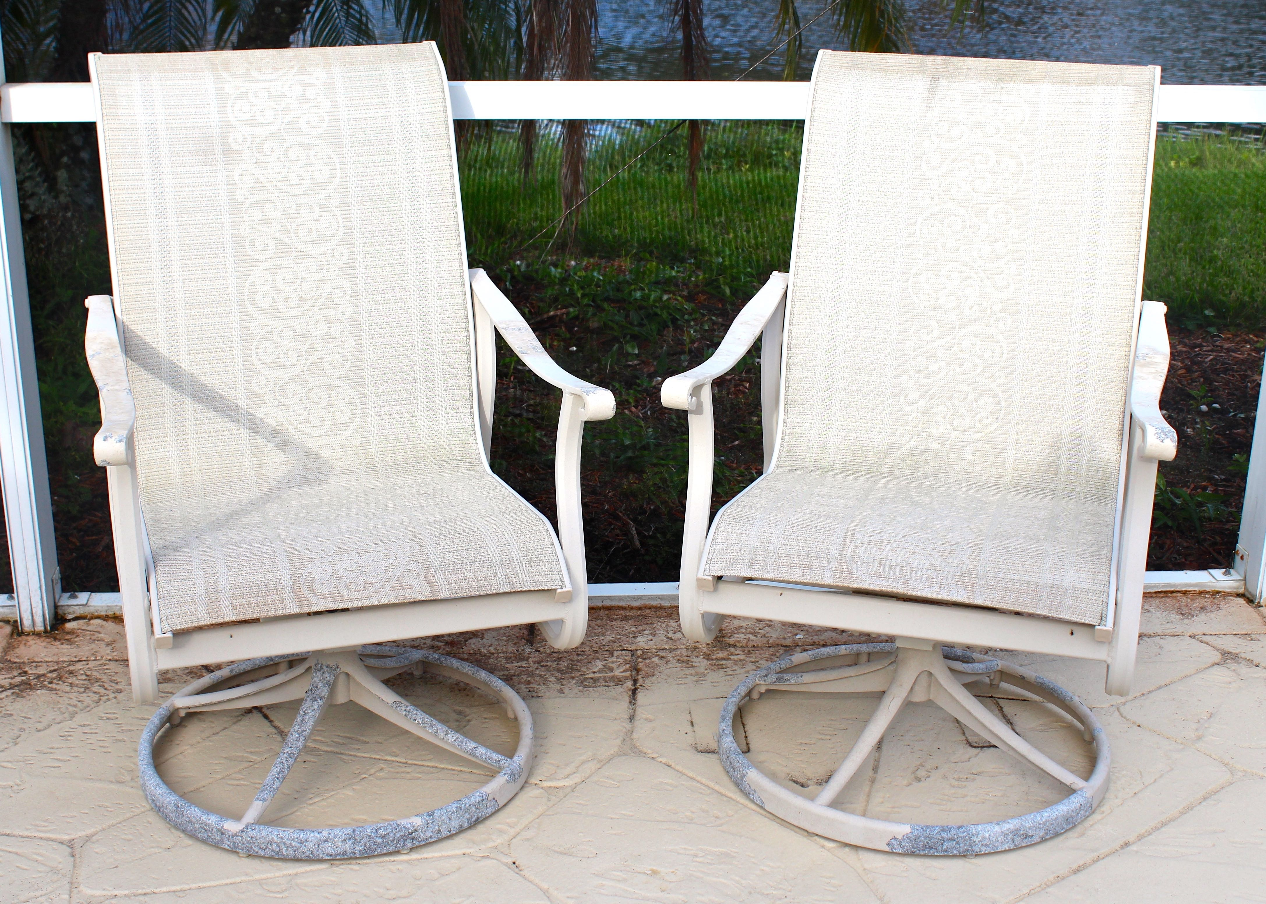 Pair Of Carter Grandle Swivel Chairs