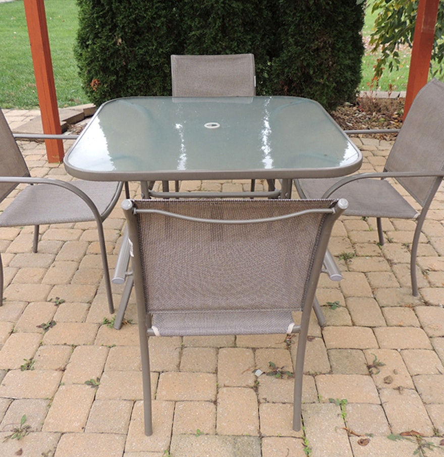 Glass top patio table and four chairs plus iron umbrella for Patio table and umbrella sets
