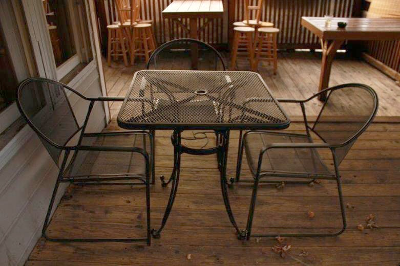 Black Metal Patio Table With Three Chairs