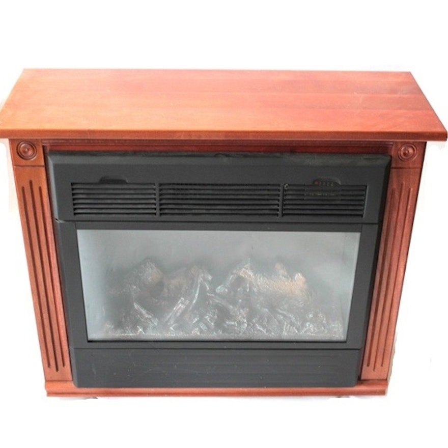 A Heat Surge model number ADL-2000M-X electric fireplace with faux logs