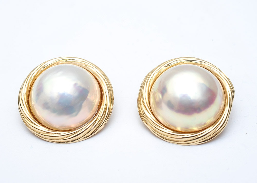 pair of mabe pearl and 14k yellow gold earrings ebth