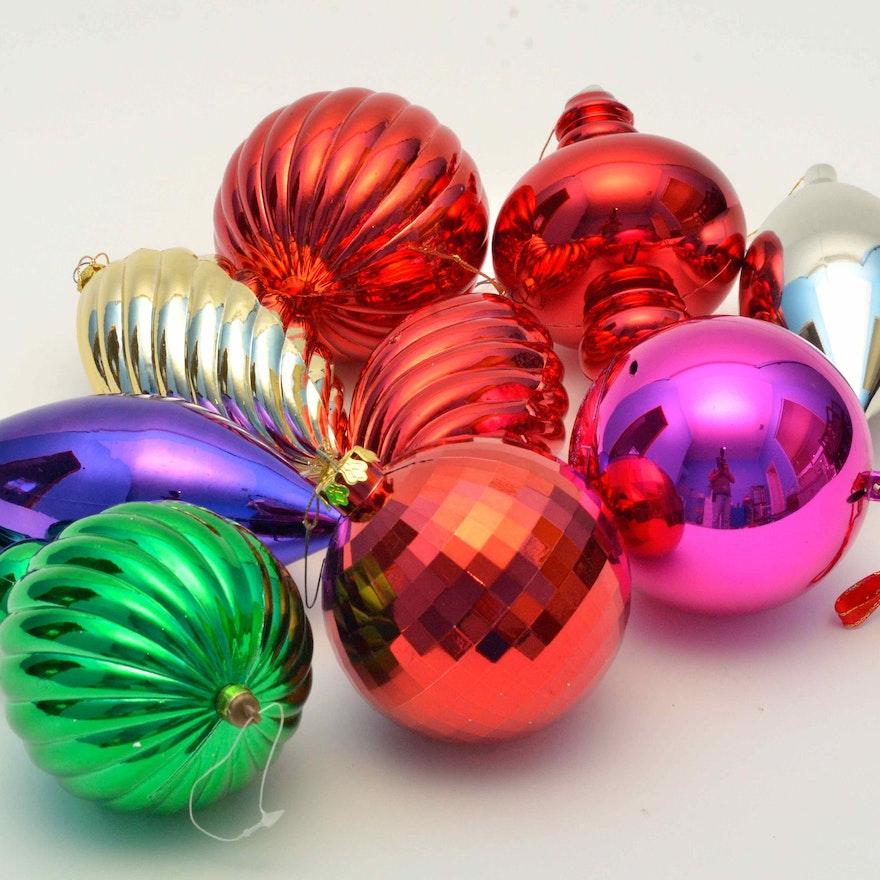 dozens of large plastic ornaments