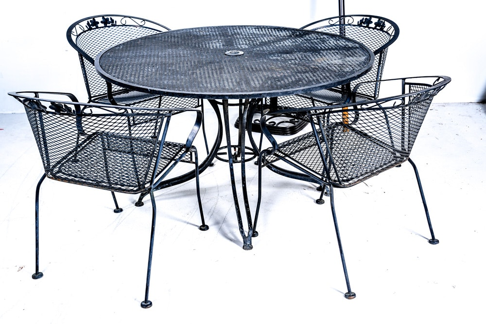 Mesh Metal Patio Table Chairs And Umbrella Ebth