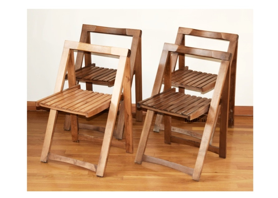 four midcentury wooden folding chairs made in yugoslavia
