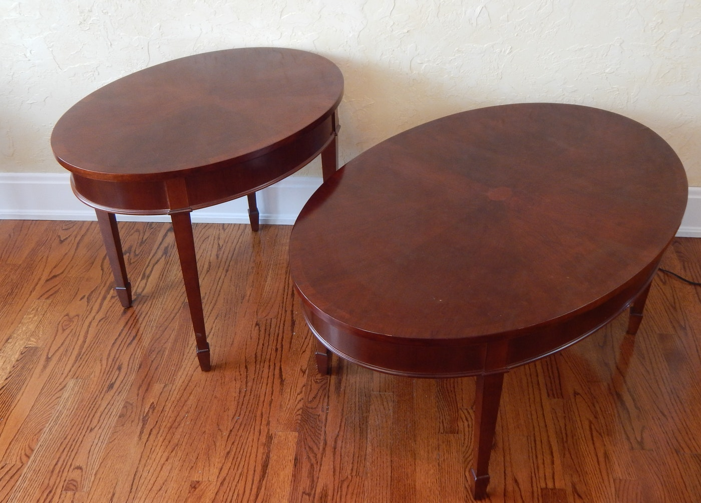 Two Bombay Company Oval Tables Ebth