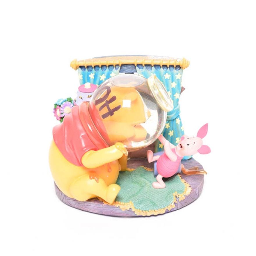 pooh in honey jar snow globe by disney ebth