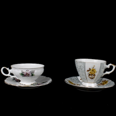 Two Lovely Porcelain Tea Cups With Saucers