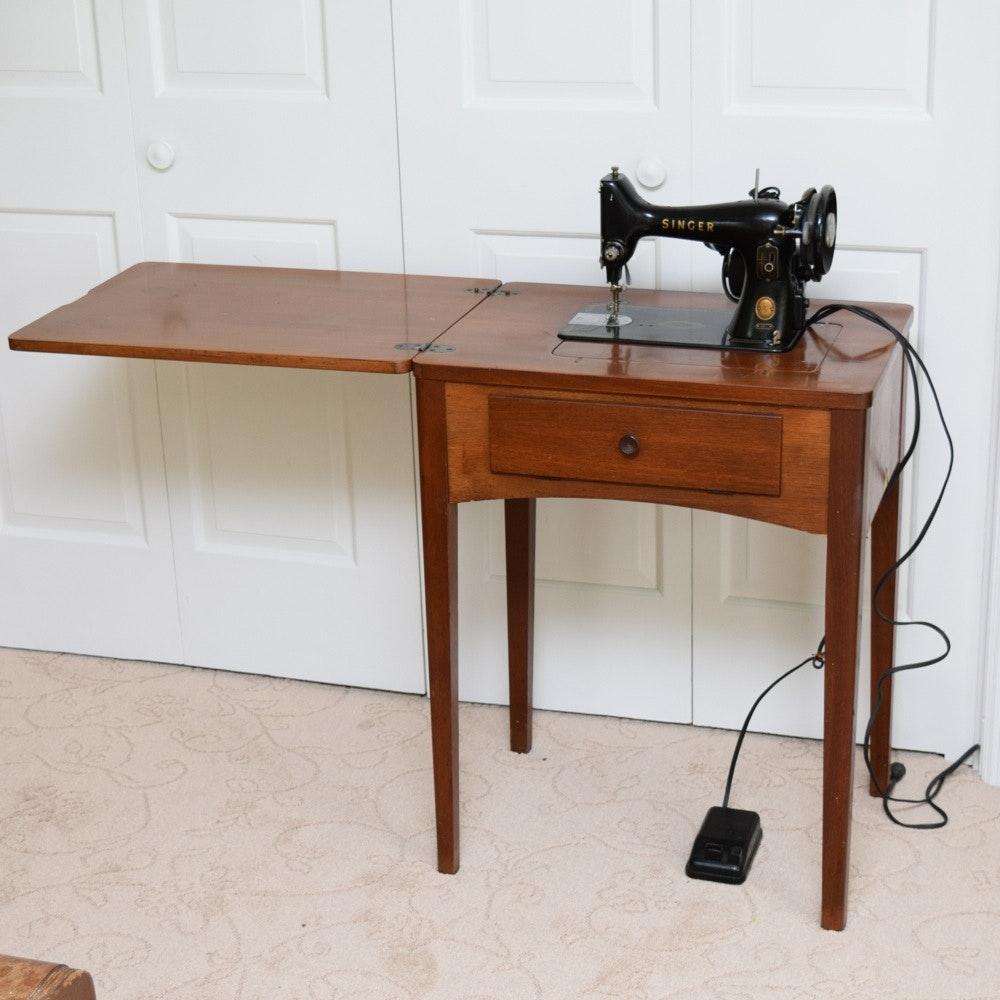 vintage singer sewing machine in cabinet