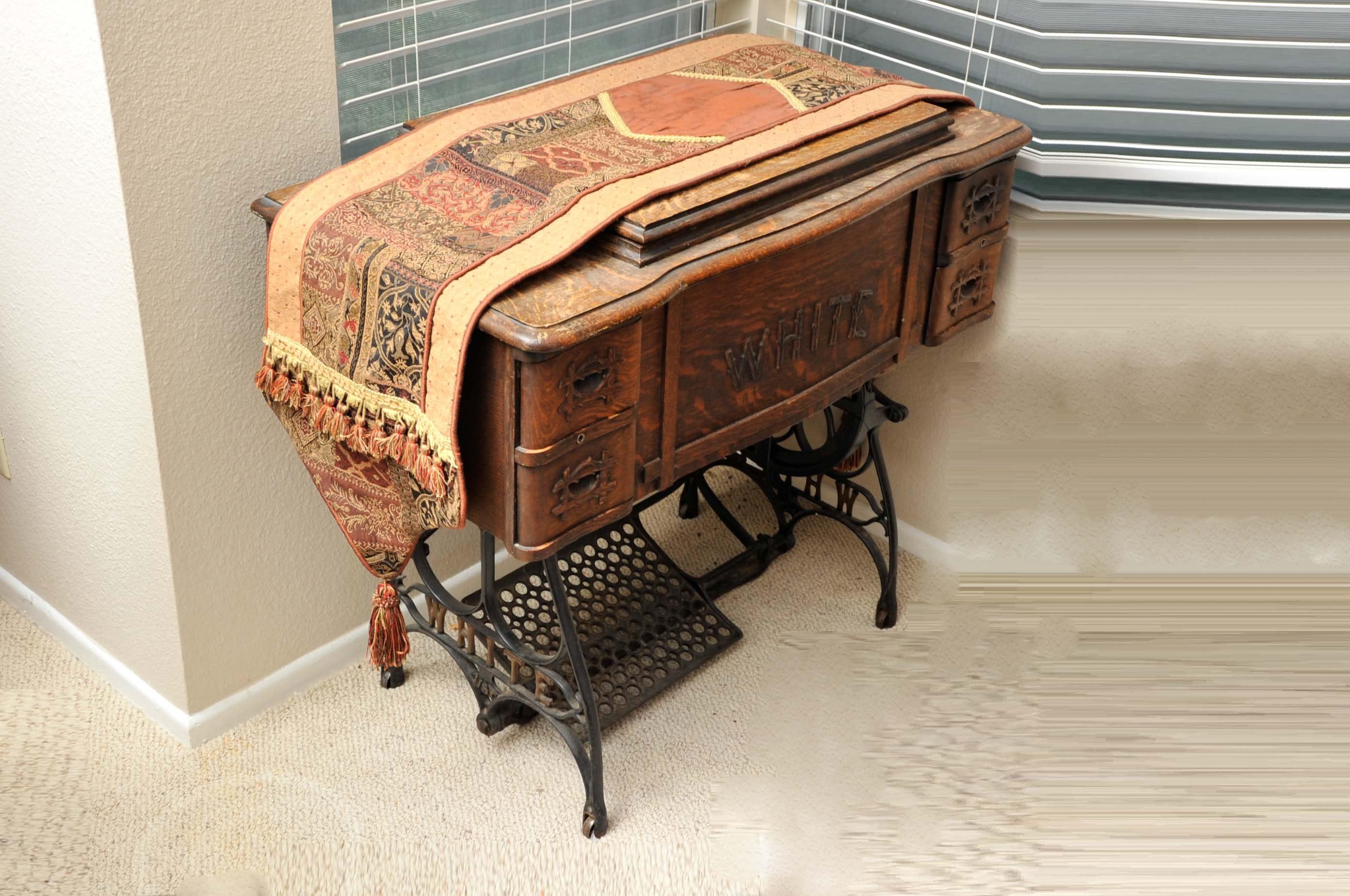Antique Treadle Sewing Machine and Quarter Sawn Oak Cabinet