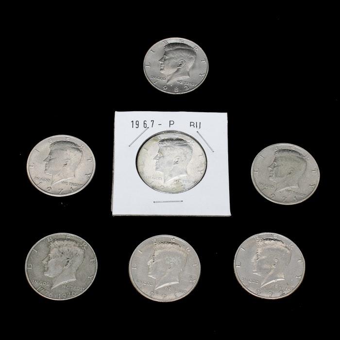 Seven John F. Kennedy Half Dollars