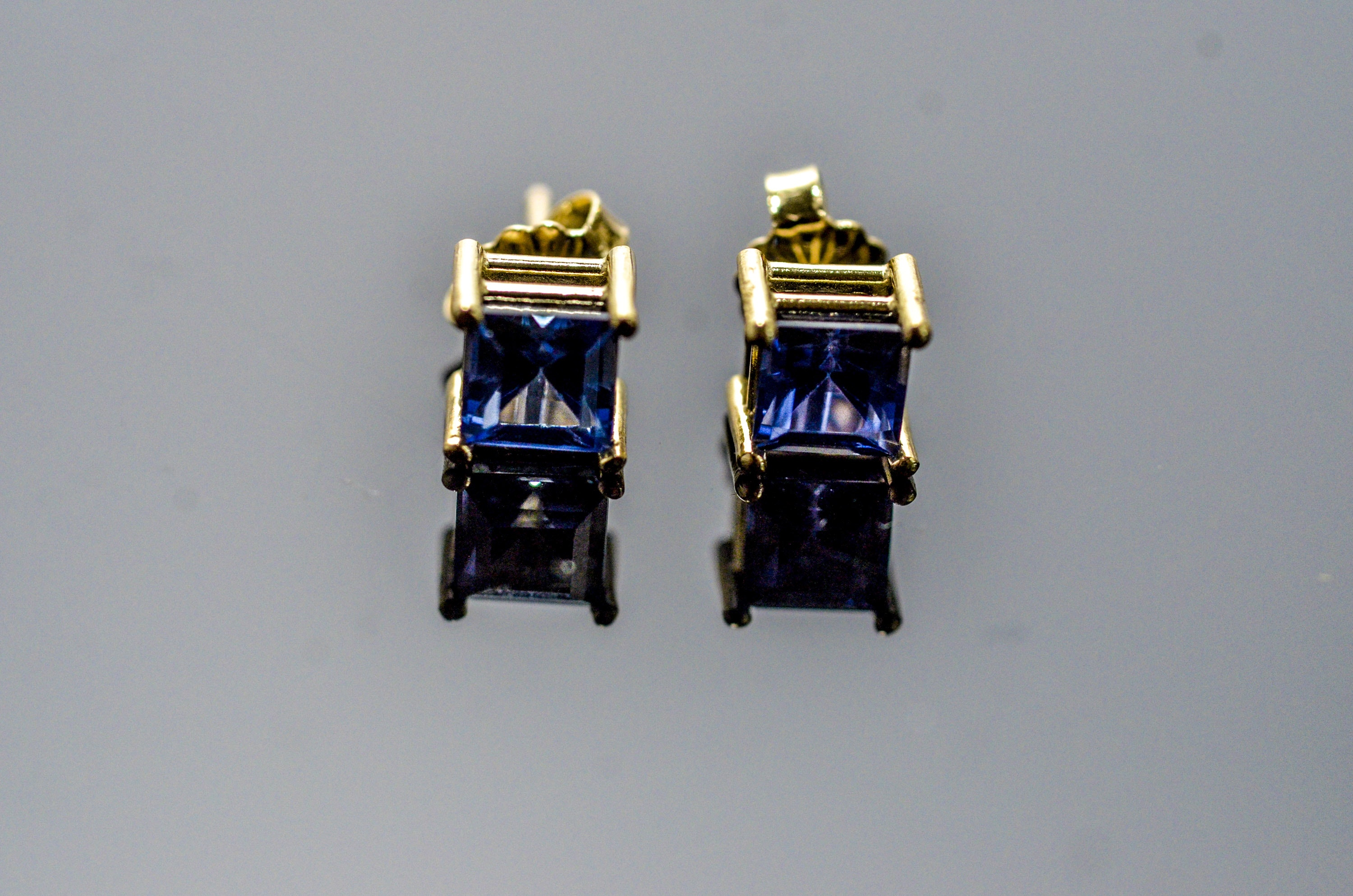 Pair 14k Yellow Gold and Blue Stone stud earrings