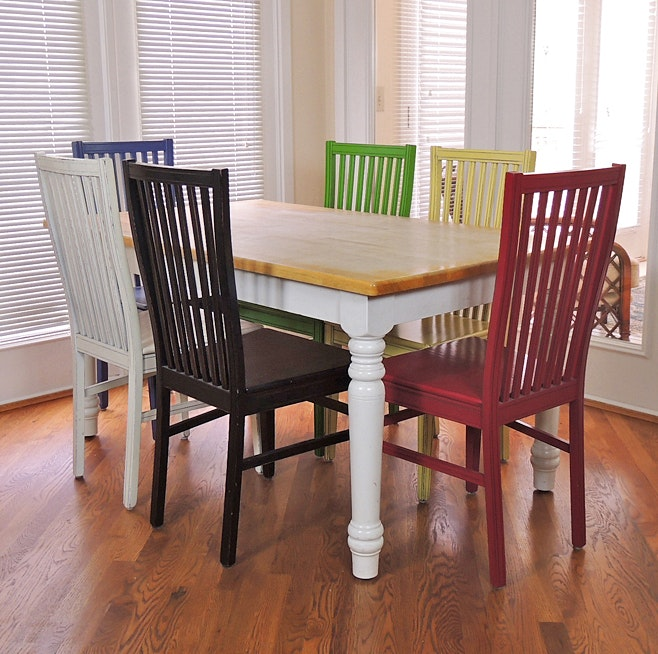 Farmhouse Kitchen Table And Six Multi Colored Chairs ...