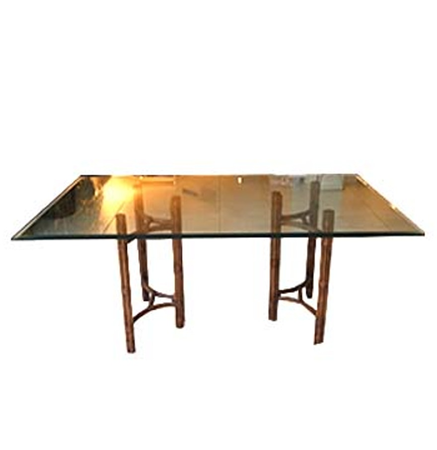 glass dining table with wooden supports ebth