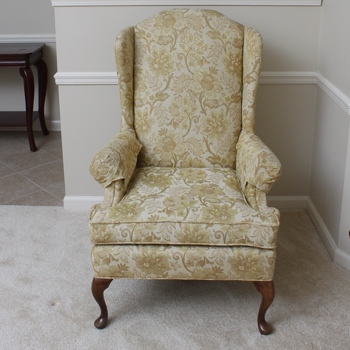yellow embroidered wingback chair by suggs and hardin