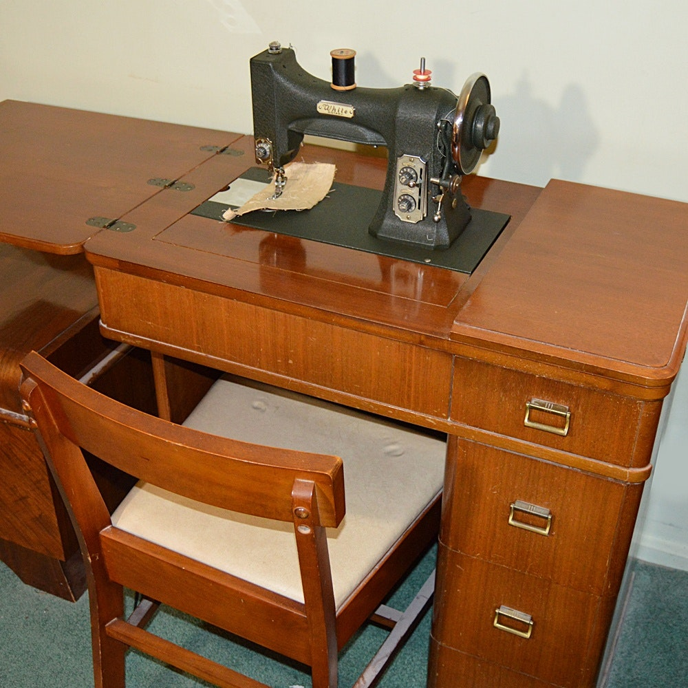 vintage white sewing machine with art deco cabinet