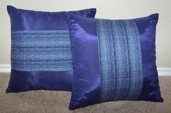 Brown Leather Couch And Blue Striped Accent Pillows Ebth