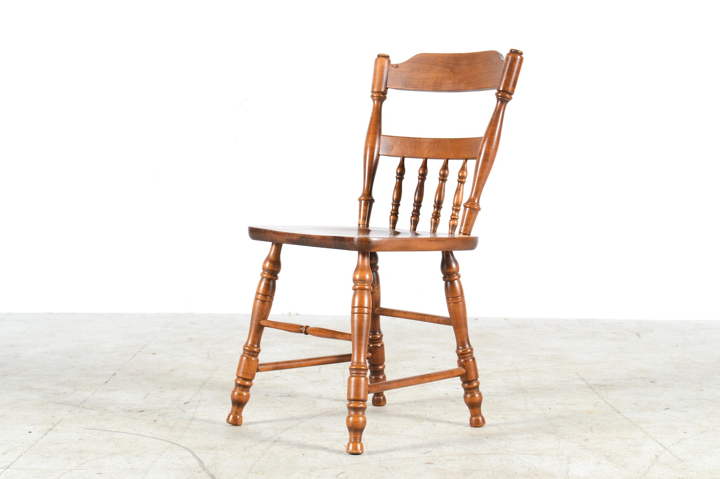 Four Walnut Dining Chairs From Moosehead Furniture Company