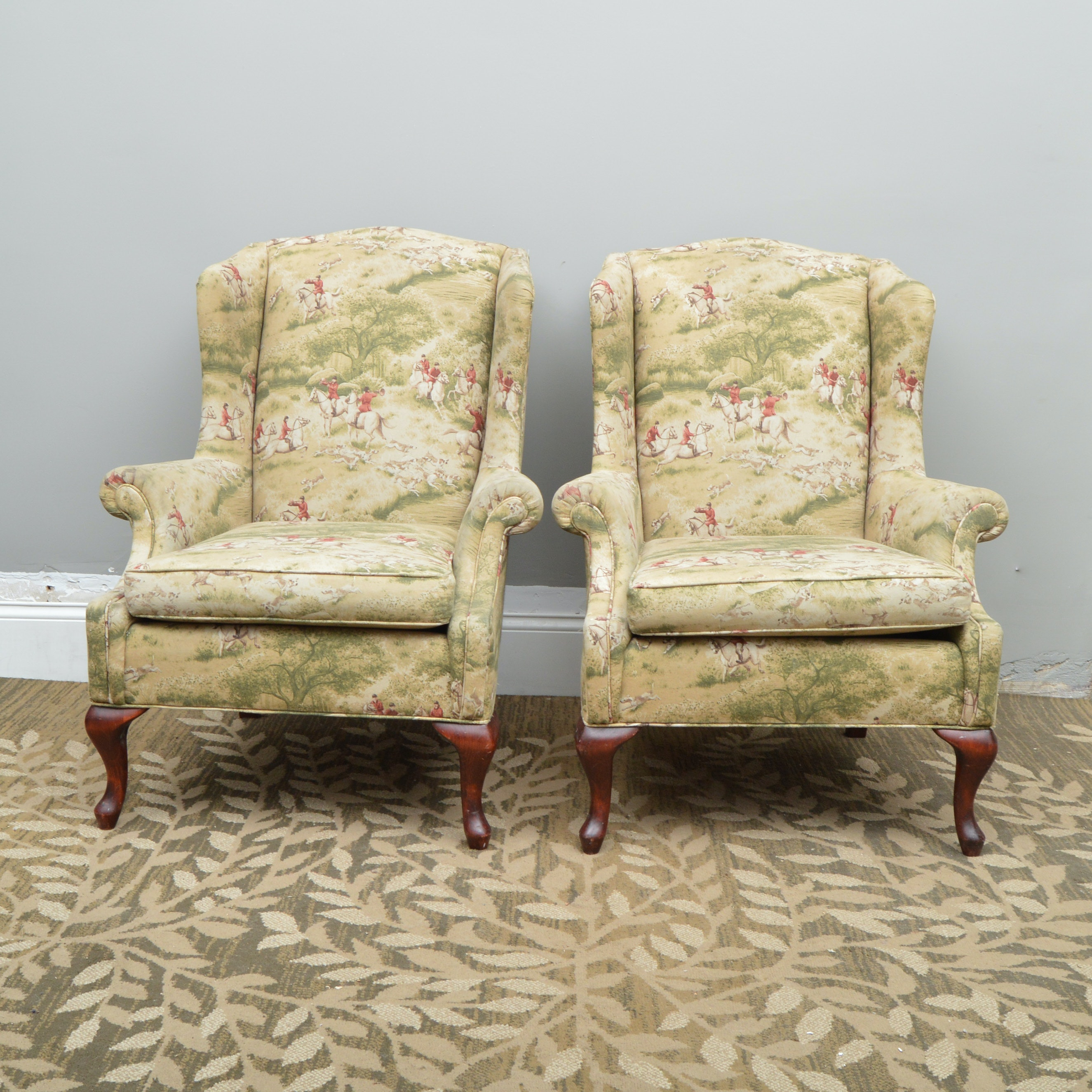 pair of fox hunting themed upholstered wingback chairs