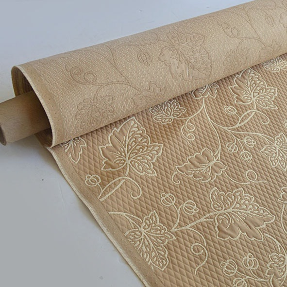 Roll of Beige and Cream Patterned Cotton Fabric
