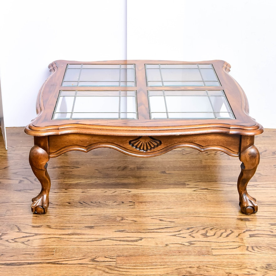 An Oak Finish Glass Top Coffee Table With Four Glass