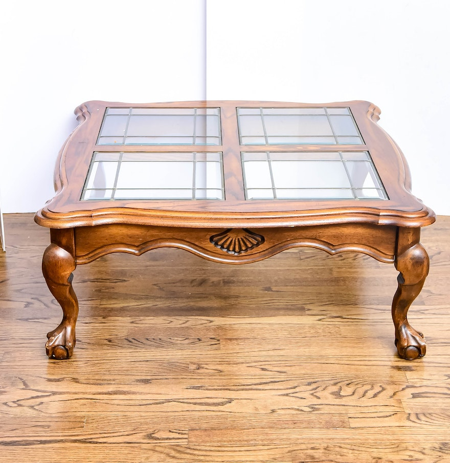 An Oak Finish Glass Top Coffee Table With Four Glass Inserts Ebth