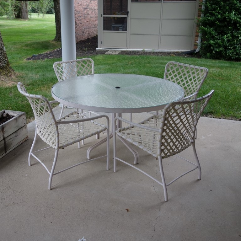 brown jordan tamiami glass top patio table and four chairs
