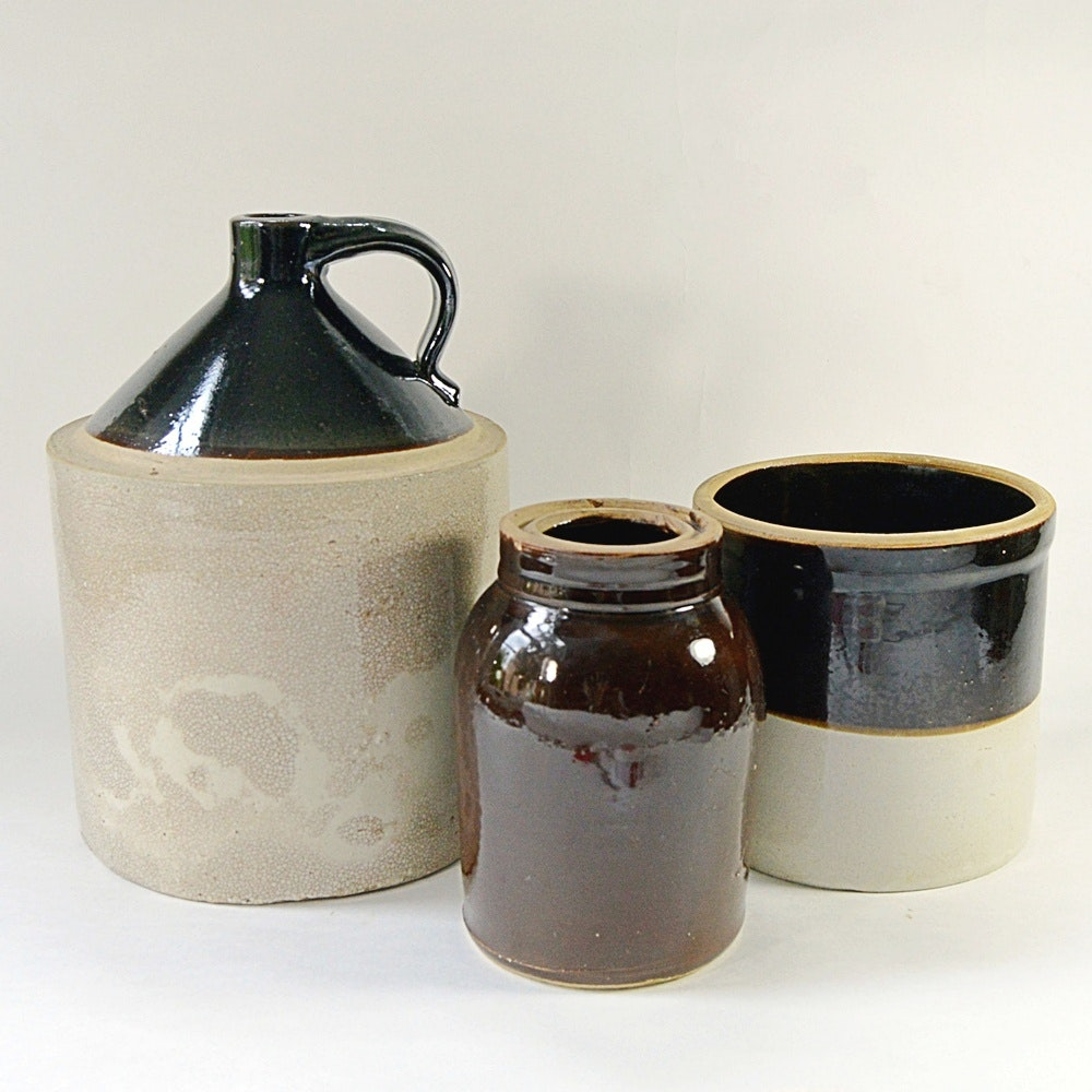 Three Antique Crocks, with One a Whiskey Jug
