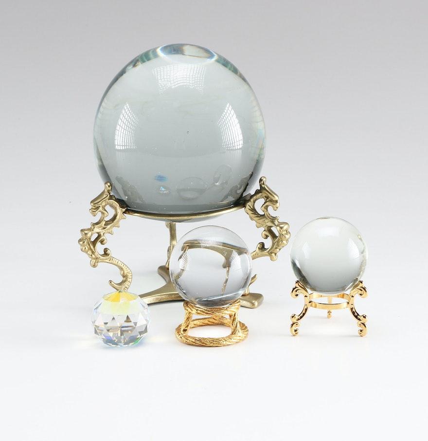Three glass balls and a crystal ball ebth