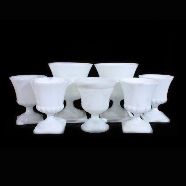 Seven Milk Glass Pedestal Vases