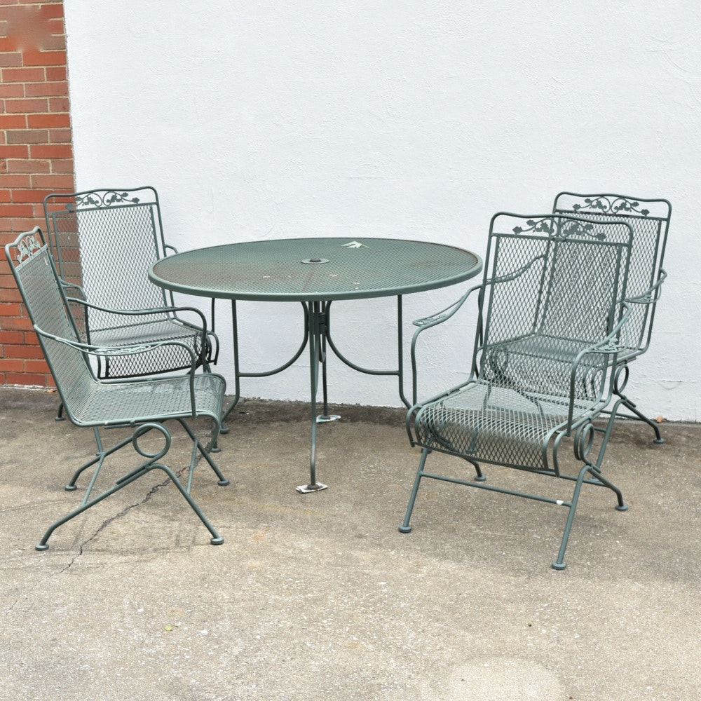 Wrought Iron Patio Table And Four Wrought Iron Rocking Chairs Ebth