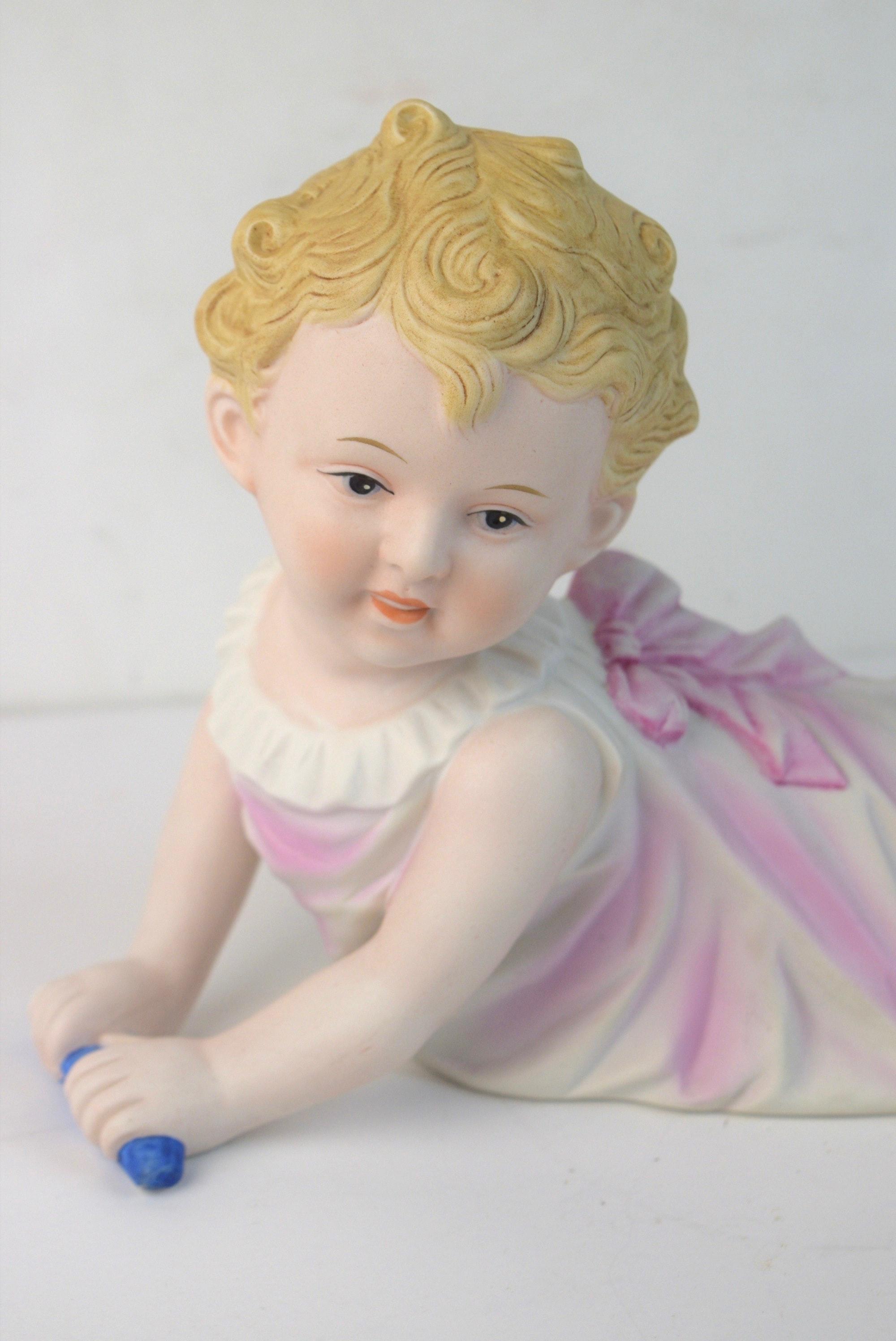 Piano Baby Bisque Figurine Ebth
