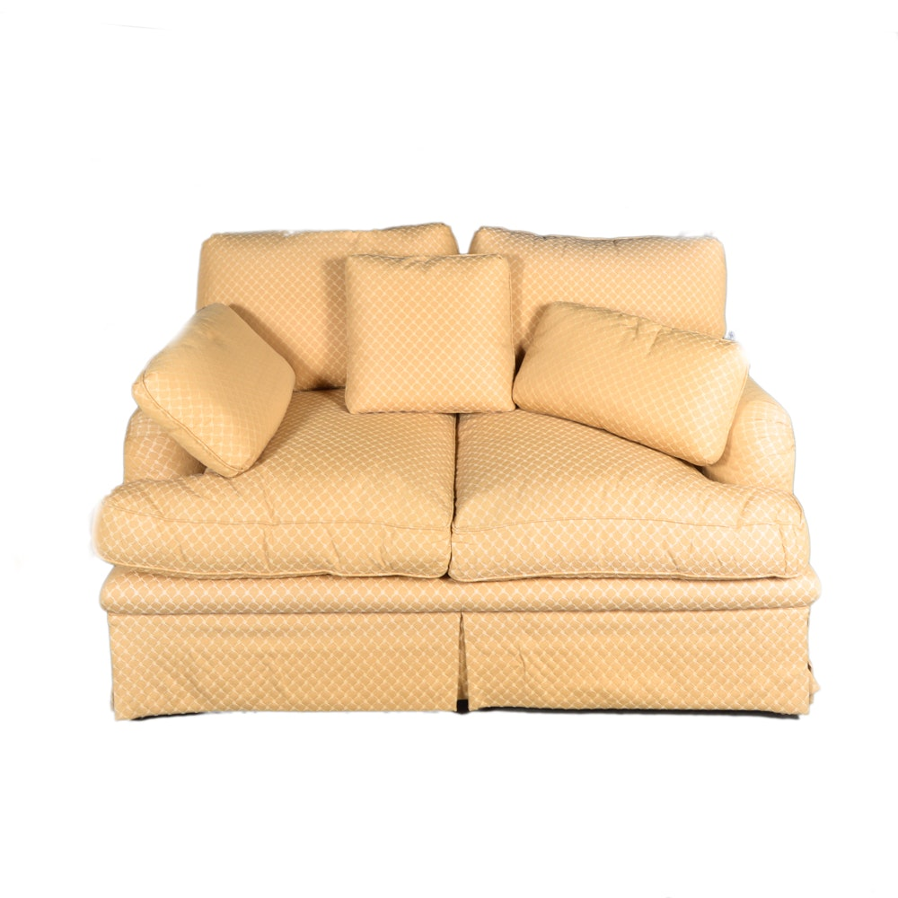 Yellow Upholstered Love Seat With Throw Pillows