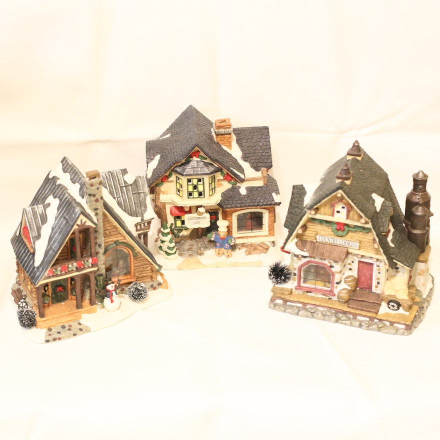 trio of lighted houses from the christmas village