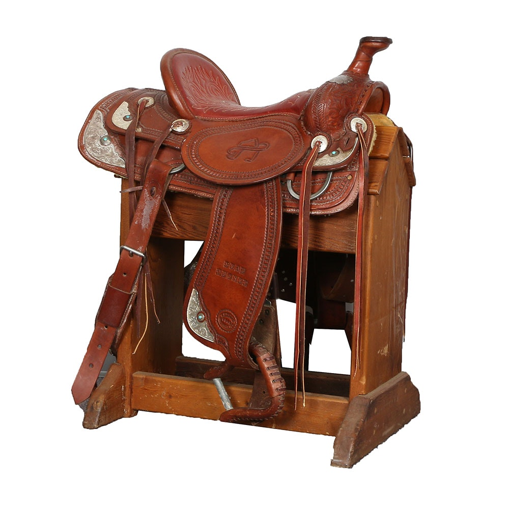 Vintage Beau Tucker Embossed and Hand Tooled Western Saddle with Tanya's Logo Designed by R.E. Donaho of San Angelo, Texas on Saddle Stand
