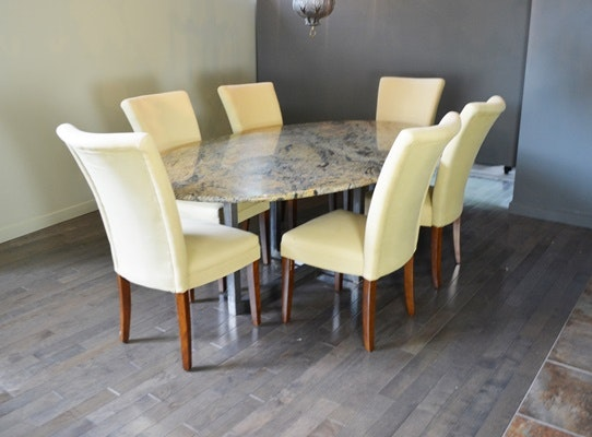 Oval Granite Top Dining Table and Six Beige Chairs