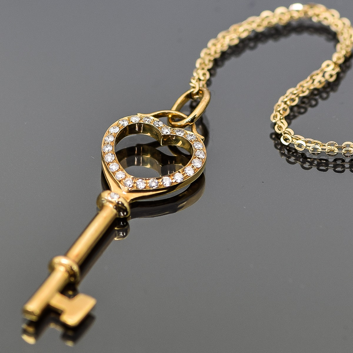 18K Yellow Gold and Diamond Turn Key Pendant Necklace