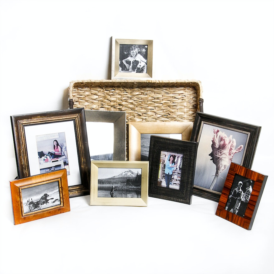 Assortment of Picture Frames in a Wicker Basket : EBTH