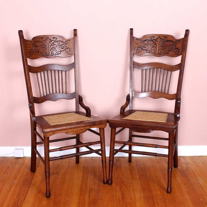 Pair Of Carved Wood Chairs With Cane Seats