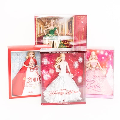 Four Collectible Holiday Barbies in Boxes