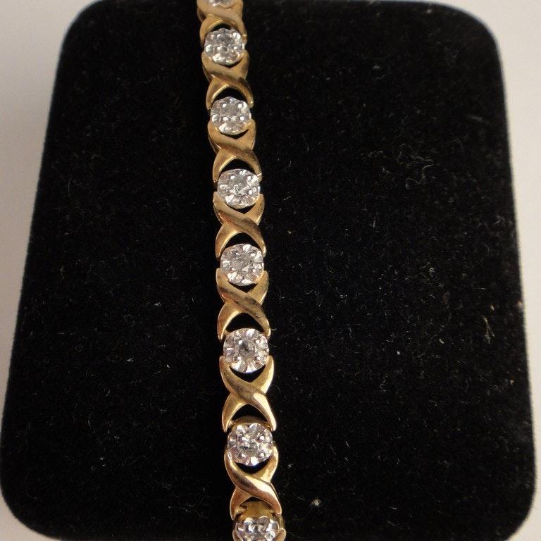 Lady's 10K Yellow Gold Line Tennis Bracelet