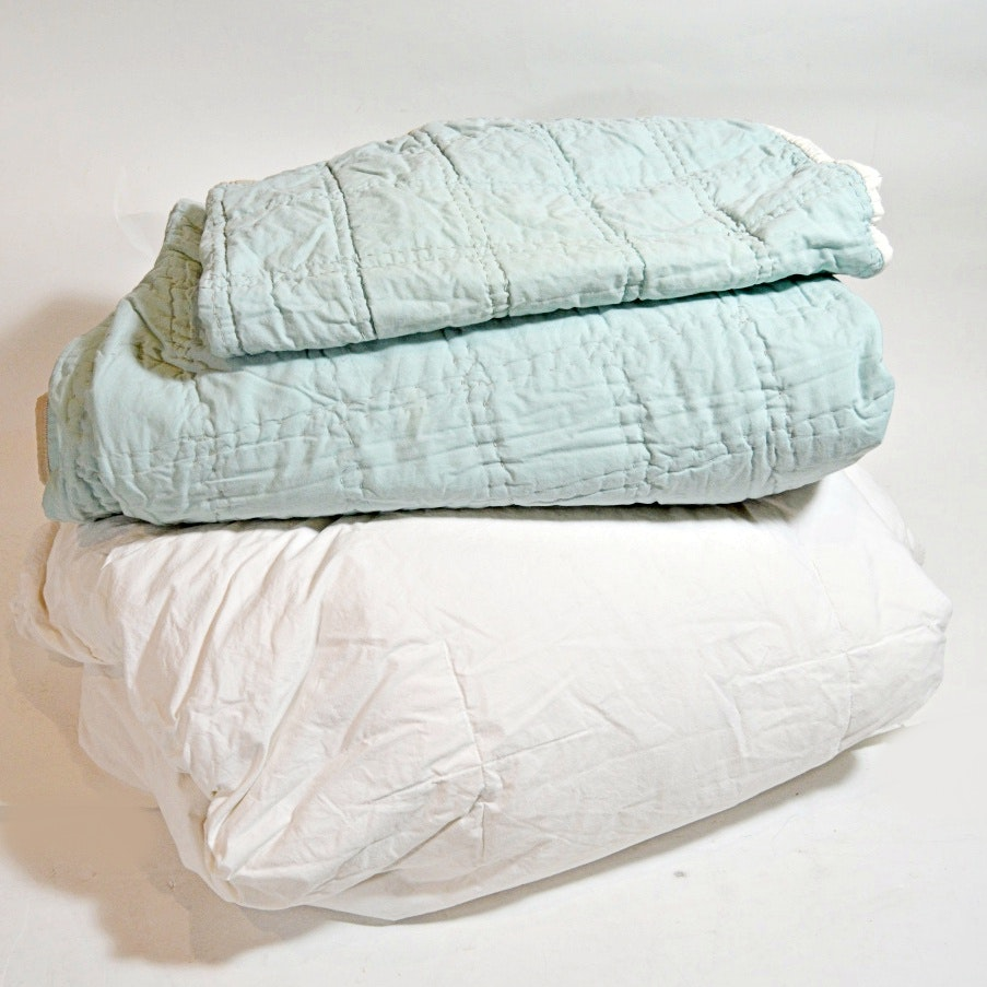 Bed Linens in White and Pale Blue with Down Comforter