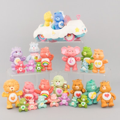 Dozens of Vintage Care Bears Posable Figurines and Cloud Car