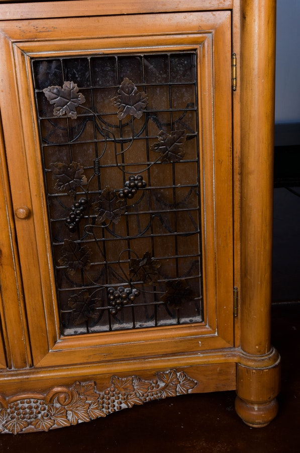 Ornate Wine Cabinet With Glass And Iron Door Panels Ebth
