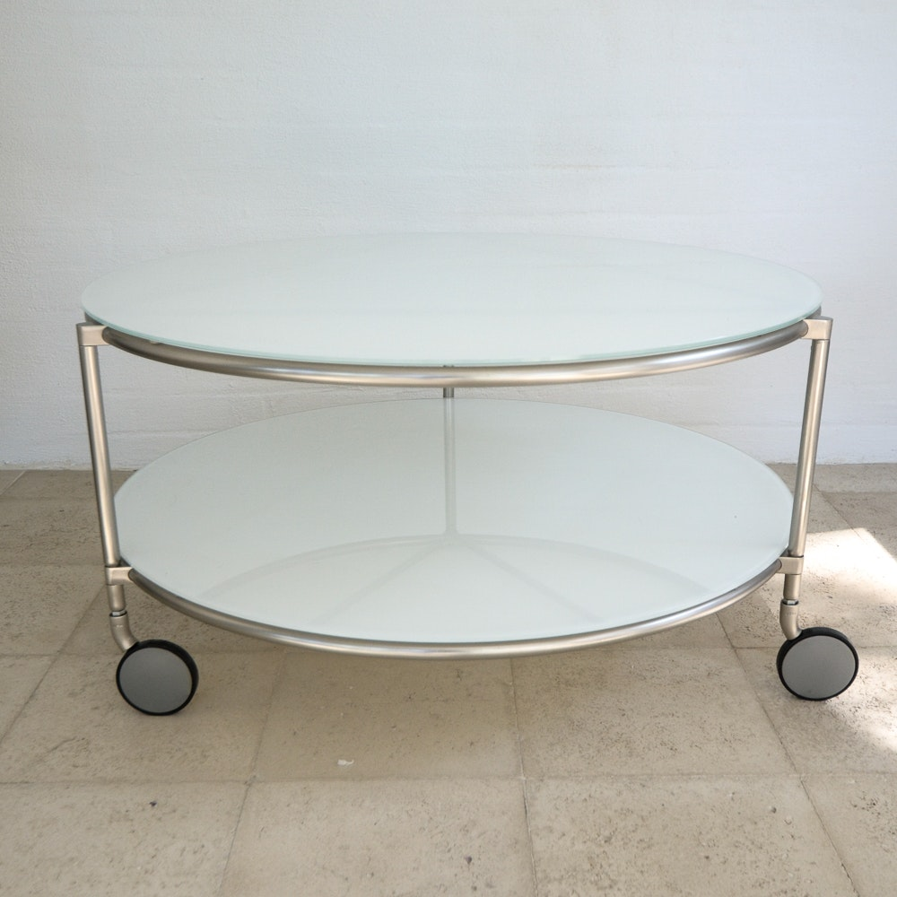 modern white glass round coffee table on casters : ebth