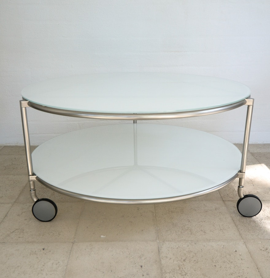 Modern white glass round coffee table on casters ebth modern white glass round coffee table on casters geotapseo Gallery