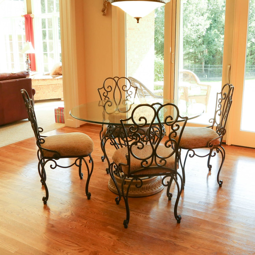 Wrought iron glass top table with five chairs by the for Best furniture company