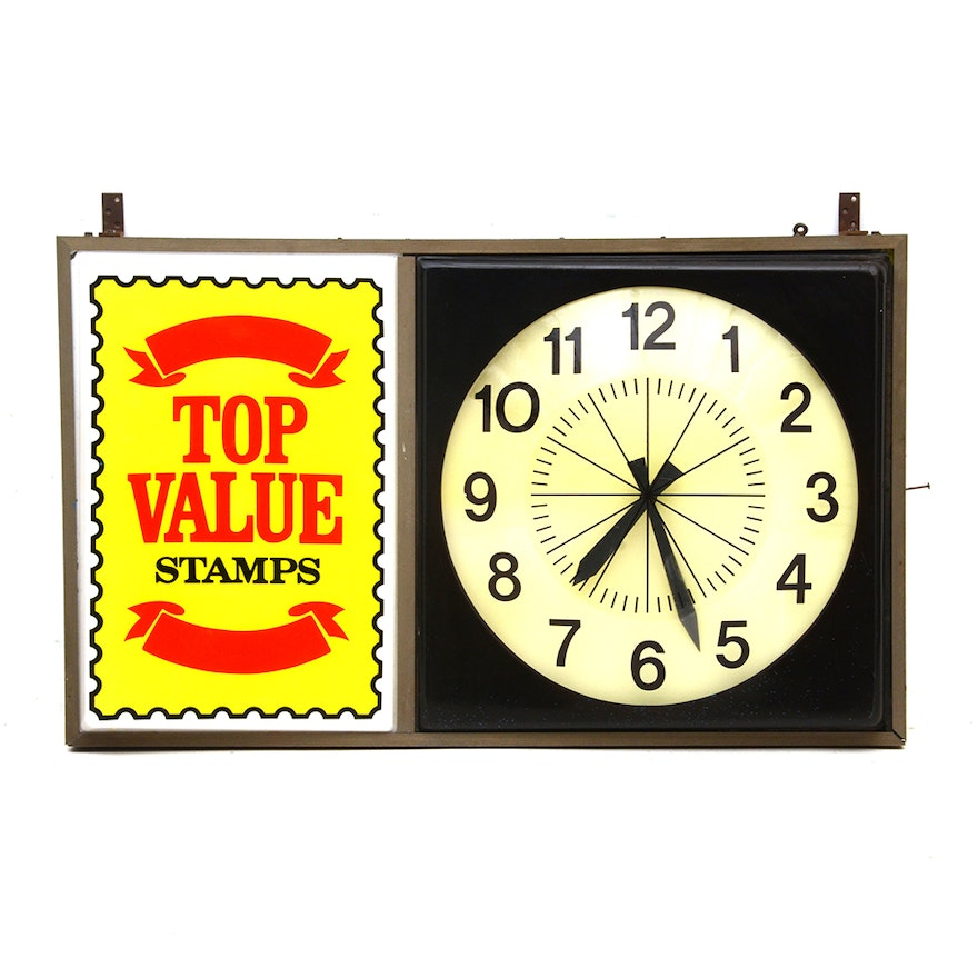 Top Value Stamps Clock Sign
